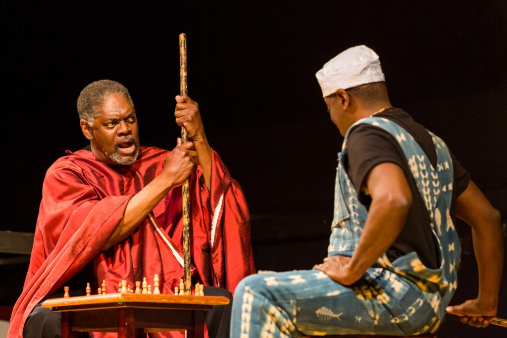 """Johnny Lee Davenport (Great Grand Daddy Deus) and Regie Gibson (Great Grand Paw Sidin) in """"black odyssey boston"""". Photo: Maggie Hall."""